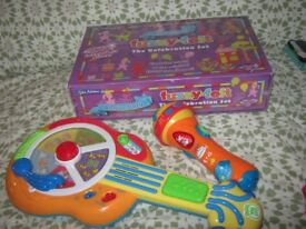 leapfrog guitar, vtech microphone and new sealed fuzzy felts £12
