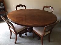 Victorian mahogany tilt-top oval table with 4 antique balloon-back chairs
