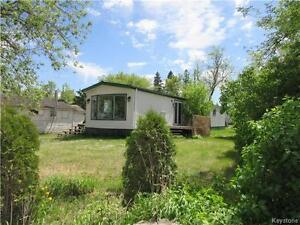 Mobile home on a large corner lot in Miniota MB