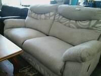 Reclining grey lounge sofa