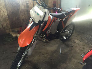 2012 KTM 200 XCW (only 100 km's &  5.2 hours)