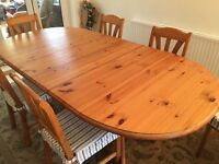 Antique Pine oval dining table (extendable) and 6 chairs in good condition