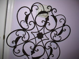 Wrought-iron wall plaque