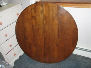 vintage  solid  mahogany dining room round table in good shape**