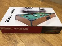 Mini pool table still in box with cues balls, brush and triangle