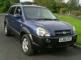 56 REG HYUNDAI TUCSON 2.0CRTD CDX 4X4 5 DOOR ESTATE IN METALLIC BLUE HPI CLEAR