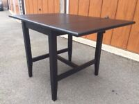 Black wood two leaf folding dining table