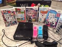 Nintendo Wii, 3 controllers and 5 games. Perfect condition!
