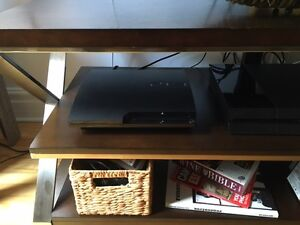 PS3 slim like new 160gigs + 17 games + 2 controllers