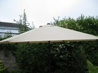 Brand new unused large luxury beige parasol still in packaging.