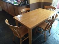 Solid wood table with x4 chairs.
