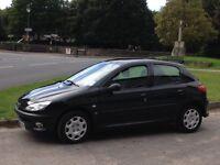 Peugeot 206 SE 2004(54) 1360cc . 5 Door Hatchback. Full year MOT.Black with smart navy upholstery.