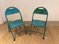 Pair of blue metal folding chairs