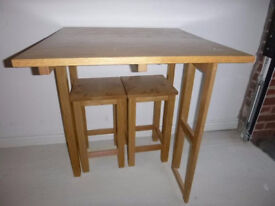 Solid Oak extending breakfast/cafe table and stools