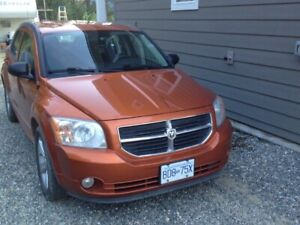 2011 Dodge Caliber with new studded winter tires on rims