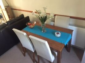 Wooden dinning table and 4 cream chairs