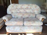 2 SEATER SETTEE-AS NEW-QUALITY ITEM-SOLID WOOD FRAME-NEUTRAL COLOUR-ART DECO PATTERN-VERY WELL MADE