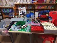 Thousands of assorted Lego pieces, bases, people and so much more.
