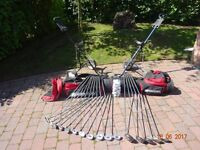 Golf Clubs. with bags and trollies.