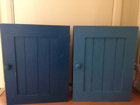 Two small bathroom wooden cabinet in blue