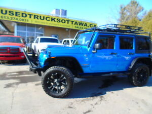 2015 Jeep Wrangler Unlimited Sahara Automatic W/lift kit tires!!
