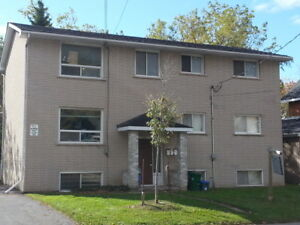 LOVELY 2 BEDROOM NEAR QUEEN'S WITH PARKING - 516-1 Brock St