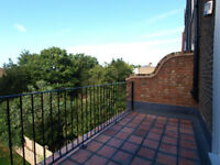Modern & bright 2 double bedroom flat 1st floor flat with a private roof terrace moments from FBtube