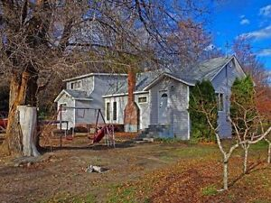 7.5 Acre Fruit Orchard with Home in Oliver