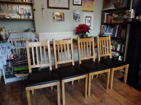 4 wooden dining chairs with faux black leather removable seats