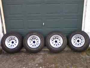 Set of 4 Rough Rider Radial A/P tires on rims