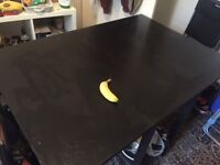 Black folding IKEA table with 2 chairs