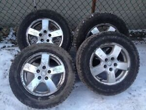 Set of 4 winter tires 215 65 16 with dodge rims LIKE NEW