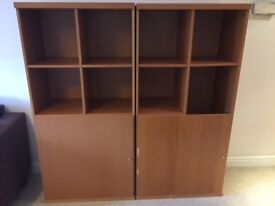 Two large wood Bookshelves/Cupboards with doors for sale