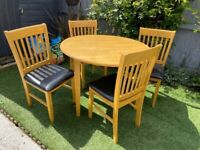 Solid circular dropleaf table and 4 chairs