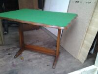 SMALL CARD TABLE. APPROX. 24IN LONG X 18IN WIDE. 18IN TALL. FOLD UP FOR STORAGE