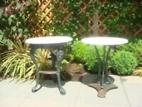 Two Marble Garden Tables with Metal Base's.