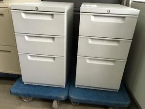 Pedestals (small file cabinets) Supply Drawers.
