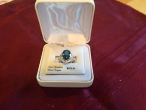Man's Wedding Band and a Genuine London Blue Topaz
