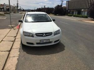 2010 Holden Ute VE MY10 Omega White 4 Speed Automatic Utility Fyshwick South Canberra Preview