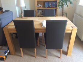 Solid oak table with 4 leather chairs - excellent condition