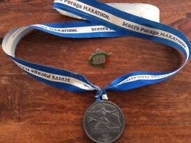 MEDALS FROM 1983 GLASGOW AND 1984 MACAU (CHINA) MARATHONS