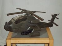 Armed forces attack helicopter in original box with army man.