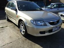 2003 Mazda 323 BJ Astina Shades Champagne 5 Speed Manual Hatchback Preston Darebin Area Preview