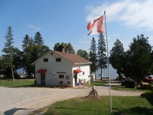 HUNT CAMP NESTLED ON THE SHORES OF LAKE TEMISKAMING