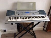 Used Casio CTK-591 musical keyboard (61 keys) with stand