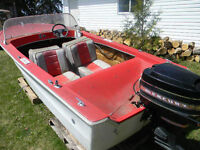 35 HP mercury outboard motor and boat
