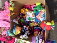 Box of plush toys for infants/toddlers