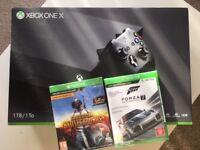 XBOX ONE X 1TB BRAND NEW SEALED WITH TWO GAMES