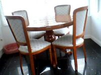 Highly pollished round table 4 chairs extends to large oval very good condition