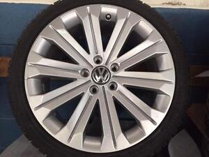 "Brand new OEM vw 18"" (spoken) package"